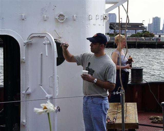 Eric Weisler gives the fireboat John J. Harvey a coat of paint.