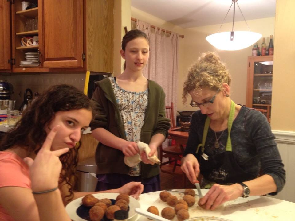 Merging minhagim: Filling sufganiyot with pumpkin pastry cream with my favorite sous chefs.