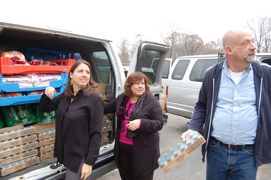 Maria Dowlng, CEO of Rockland Jewish Family Service, left, works with Diane Serratore, executive director of People to People, and Rob Mauer, executive director of TOUCH, at a food pickup for Rockland County food pantries coordinated by RJFS.