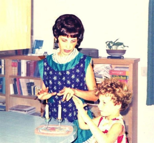 The author, Marla Cohen, lights Shabbat candles with her mother, Miriam in the late 60s.